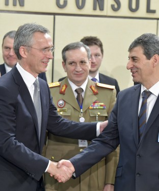 Left to right: NATO Secretary General Jens Stoltenberg with Mihnea Ioan Motoc (Minister of Defence, Romania)