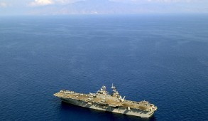 011031-N-9815L-002  Dili, East Timor (Oct. 31, 2001) Ð The amphibious assault ship USS Essex (LHD 2) underway off the coast of Dili, East Timor.  Sailors and Marines from Essex, are supporting community relations projects including medical and dental assistance, general engineering and construction, and transport and delivery of sports equipment and infrastructure materials in Dili.  U.S. Navy photo by Photographer's Mate 2nd Class Michael B. Lewis. (RELEASED)