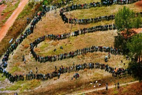 FILE - This  April 27, 1994 aerial file  photo shows long lines of people queuing outside the polling station in the black township of Soweto, in the southwest suburbs of Johannesburg, South Africa. Against all odds, the party of Nelson Mandela which  has transformed a nation where just 20 years ago black South Africans could not vote, and beaches and restaurants were reserved for whites only, is celebrating its 100th anniversary in Bloemfontein Sunday Jan 8 2012.The majority of South Africa's 22 million voters were voting in the nation's first all-race elections. (AP Photo/Denis Farrell, File)